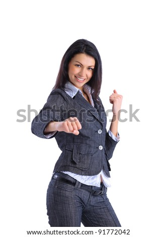 Caucasian businesswoman in a suit, ready for a fight. - stock photo