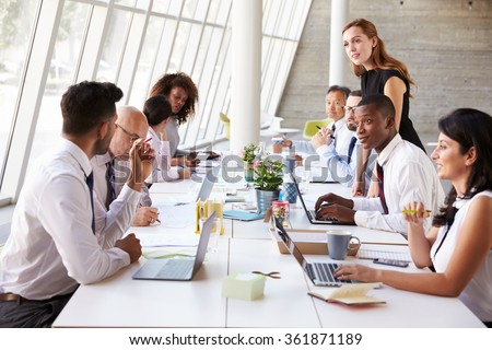 Caucasian Businesswoman Leading Meeting At Boardroom Table - stock photo
