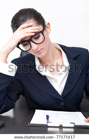 caucasian businesswoman with a headache looking in document - stock photo