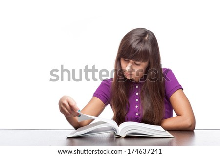 caucasian casual girl sitting at desk with open book isolated on white