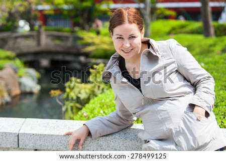 Caucasian cheerful young woman in summer japanese park. Copy space - stock photo