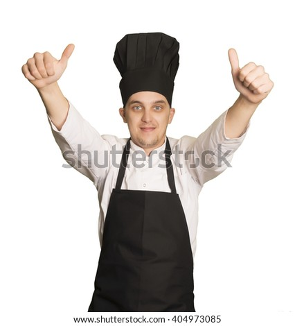 Caucasian chef boy looking at camera with a winner gesture - stock photo