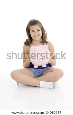 Caucasian child holding a piggy bank on her lap