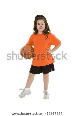 Caucasian child in a basketball uniform holding a ball - stock photo