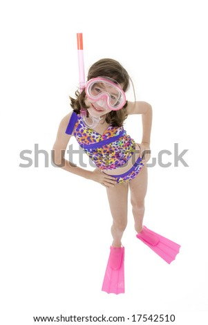 Caucasian child posing in a swimsuit standing on white background