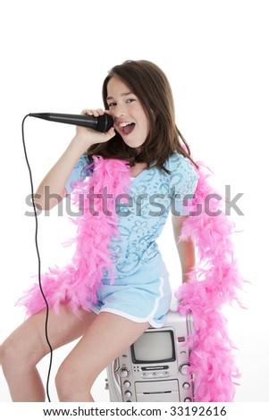 Caucasian children singing karaoke on a white background - stock photo