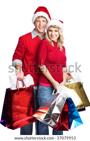 Caucasian couple doing christmas shopping and carrying shopping bags - stock photo
