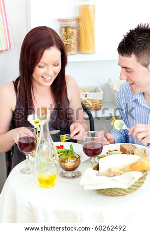 Caucasian couple having dinner in the kitchen at home