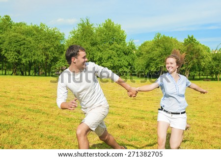 Caucasian Couple Relaxing Outdoors. Holiday and Vacation Concepts. Horizontal Image Composition - stock photo