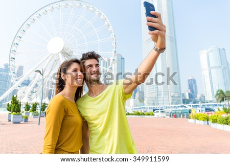 Caucasian couple take the selfie by sellphone at Hong Kong - stock photo