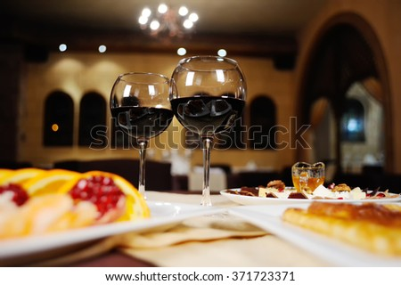 Caucasian cuisine. glasses of red wine and snacks on a table
