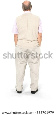 Caucasian elderly man with short grey hair in casual outfit with hands in pockets - Isolated