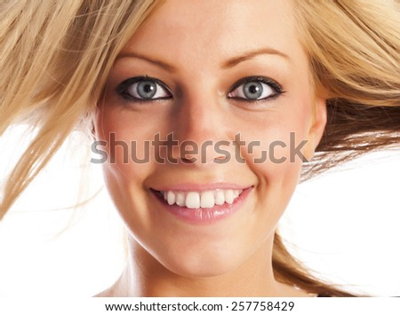 Caucasian european girl's face expressing cheerful emotions - stock photo