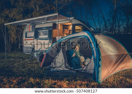 Caucasian Family Camping Fun In The Tent RV Motorhome Camper