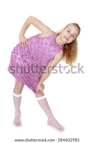 Caucasian fashionable girl in a beautiful dress and socks- isolated on white background - stock photo