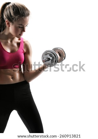 Caucasian female model with muscular fit and dumbbell / photo set of sporty muscular female brunette girl wearing sports clothes working out with dumbbell over white background  - stock photo