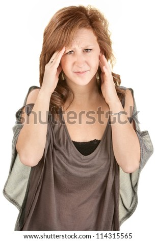 Caucasian female on isolated background holding her head - stock photo