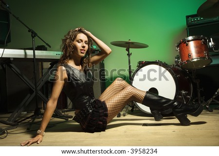 Caucasian female posing with musical equipment. - stock photo