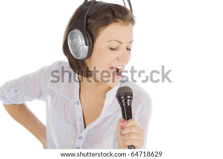 Caucasian female singing into microphone. - stock photo