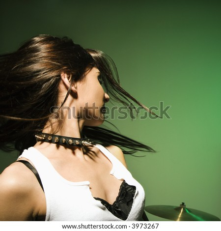 Caucasian female swinging her hair. - stock photo