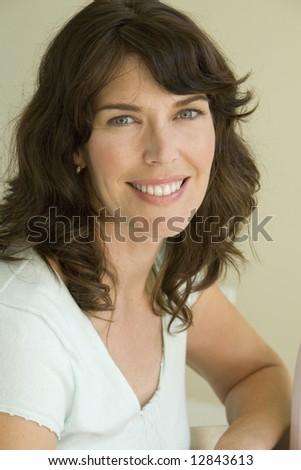 Caucasian female wearing sunglasses - stock photo