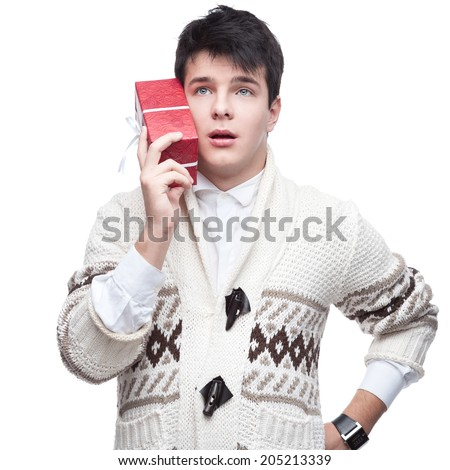 caucasian funny casual young man holding gift. isolated on white - stock photo
