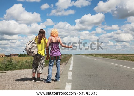 Caucasian   girl and boy  hiking at a road - stock photo