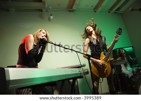 Caucasian girl band playing instruments. - stock photo