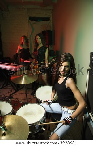 Caucasian girl band with their instruments. - stock photo