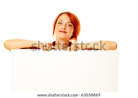 caucasian girl is holding a blank billboard - stock photo
