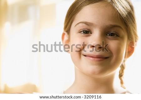 Caucasian girl smiling at viewer. - stock photo
