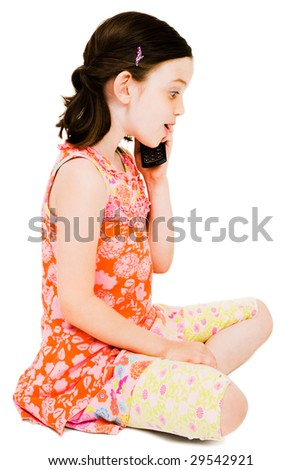 Caucasian girl talking on a mobile phone isolated over white - stock photo