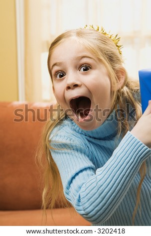 Caucasian girl with excited expression. - stock photo