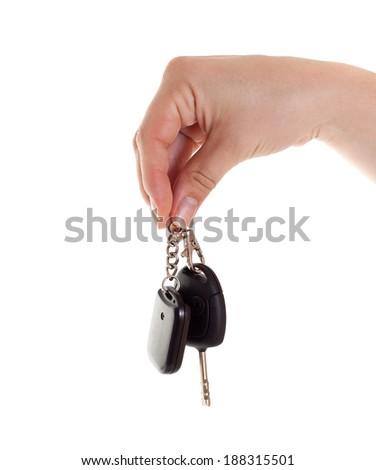 Caucasian hand holding car key, isolated on white background - stock photo