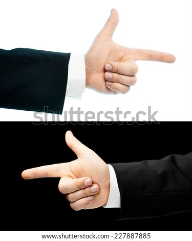 Caucasian hand in a business suit, pointing with an index finger gesture sign, set of two versions, isolated over the white and black background