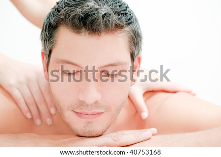 Caucasian handsome spa man getting wellbeing massage - stock photo
