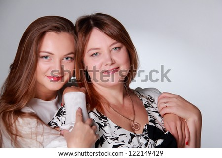 Caucasian happy and smiling daughter and mother - stock photo
