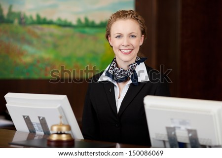Caucasian happy woman working as a professional receptionist in a hotel - stock photo