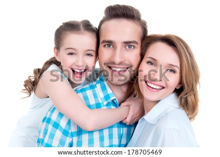 Caucasian happy young family with little girl and pretty white smiles - looking at camera - stock photo