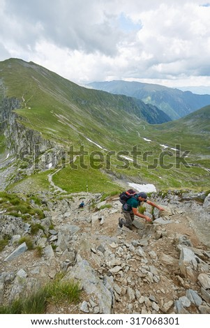 Caucasian hiker on a mountain trail in a beautiful landscape