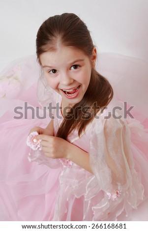 Caucasian kid wearing pink dress as a princess - stock photo