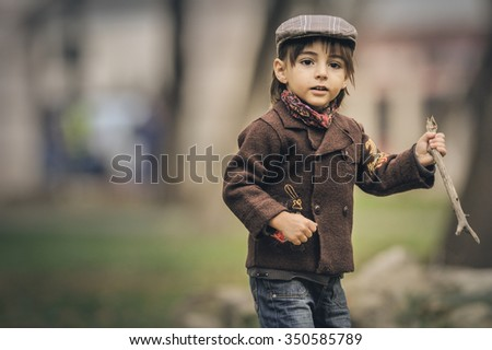 caucasian little boy in a summer day outdoors - stock photo