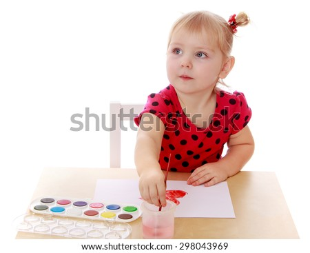 Caucasian little girl drawing on a sheet of paper with watercolors or table-Isolated on white background - stock photo