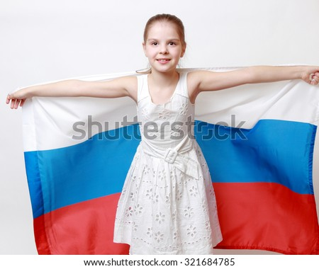 Caucasian little girl holding national flag of Russian Federation (Russia) - stock photo