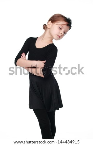 Caucasian little girl is engaged in a dance show white black suit - stock photo