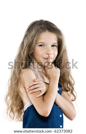 caucasian little girl portrait hush sign isolated studio on white background - stock photo