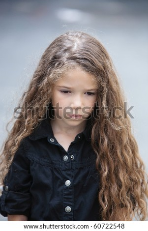 caucasian little girl portrait pout sad isolated studio on grey background - stock photo