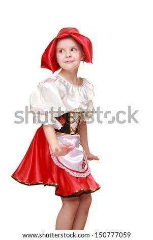 Caucasian little girl with a sweet smile in a beautiful dress and red hat on Beauty and Fashion