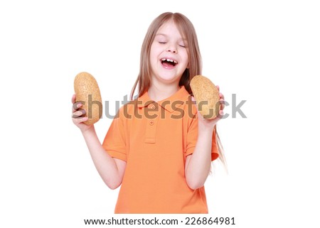 caucasian little girl with buns/little girl offers tasty bun isolated over white - stock photo