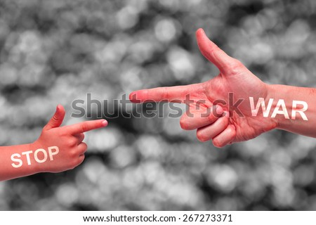 Caucasian male and boy painted red hands pointing, or gun gesture, on blurred black and white background. Stop War campaign text. - stock photo